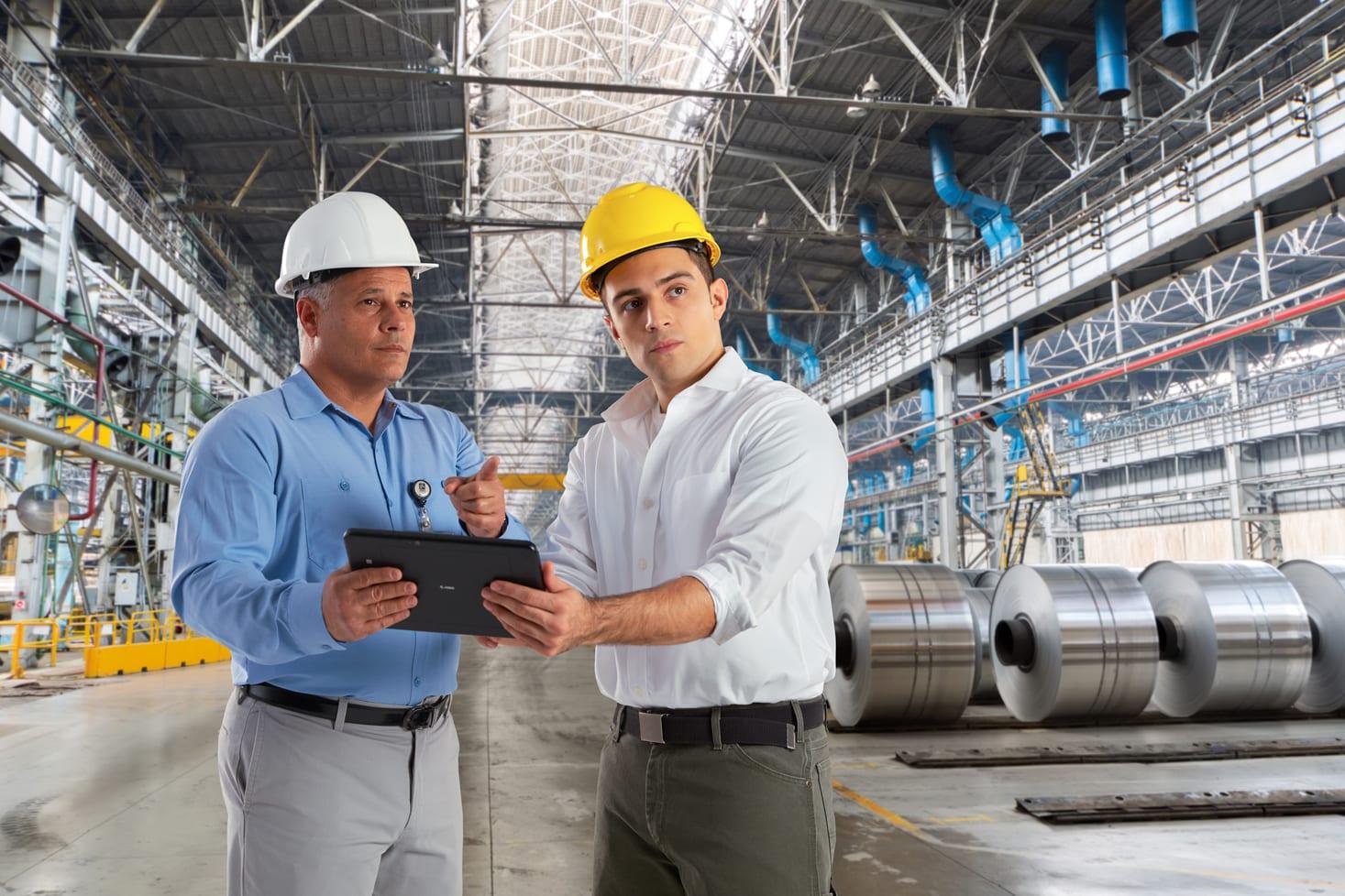 2 Men Wearing Hard Hats in Warehouse